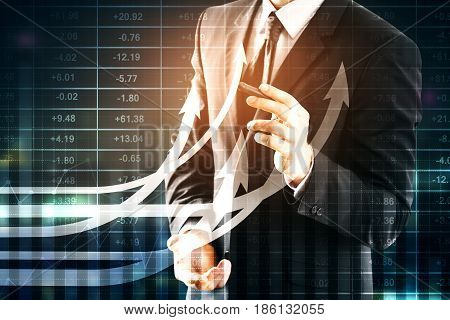 Businessman drawing creative business chart with upward arrows on night city background. Finance concept