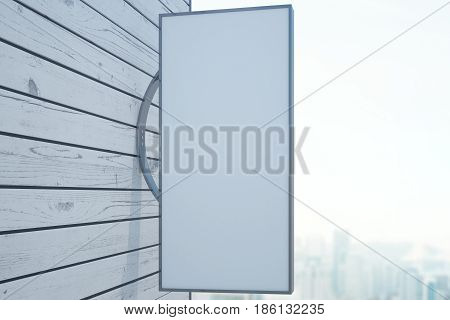 Empty vertical rectangular stopper on wooden building. Blurry city background. Mock up 3D Rendering