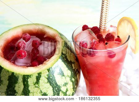 Cocktail in the watermelon fresh smoothie. A refreshing summer drink. Colorful background with white stones