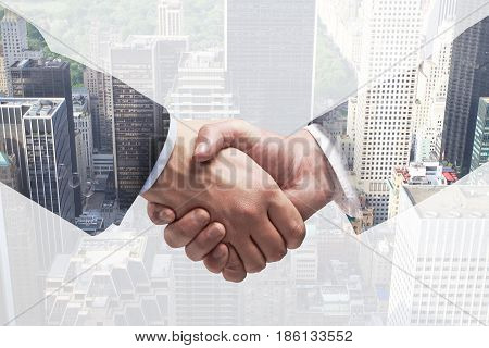 Close up of handshake on creative city background. Teamwork concept. Double exposure