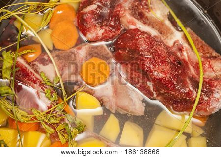Beef bone bouillon soup cooking Ingredients in souse pan