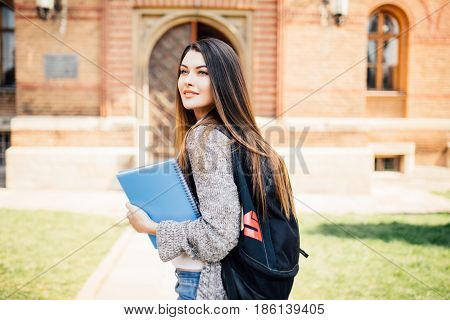American University Student Smiling With Coffee And Book Bag On Campus