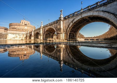 Mausoleum of Hadrian and bridge on Tiber river in Rome, Italy. The Mausoleum of Hadrian, usually known as Castel Sant'Angelo and Bridge Ponte Sant' Angelo.