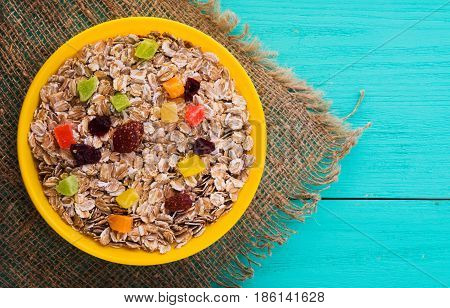 Muesli With  Dried Fruit (strawberries, Grapes, Kiwi, Peach). Muesli On A Wooden Table. Muesli Top V