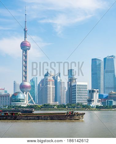 Shanghai, China - Nov 4, 2016: Close view of the Shanghai City skyline shrouded in some afternoon haze. Features the Oriental Pearl TV tower and Huangpu River.