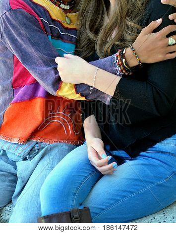 Interracial student fashion model friends bonding together outside.