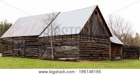Old wooden barn falling apart and weathered over time.