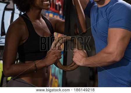 dip ring young man and african american woman relaxed after workout at gym dipping exercise