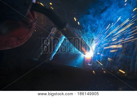 Close-up of the sparking light of the welding process.Sparking light from the welding process.
