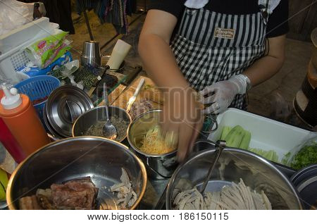 Thai Woman Merchant Cooking French Loaf Or Baguette Sandwich Vietnam Style For Sale Travelers People