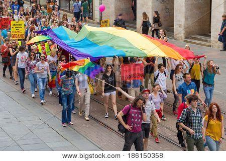 ZAGREB, CROATIA - JUNE 11, 2016: 15th Zagreb pride. LGBTIQ activists on Illica street heading to main square.