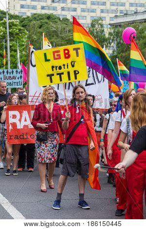 ZAGREB, CROATIA - JUNE 11, 2016: 15th Zagreb pride. LGBTIQ activists holding pride signs.