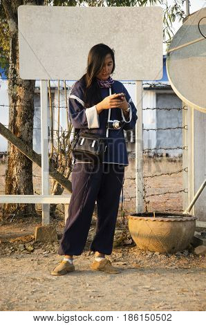 Travelers Thai Woman Visit And Playing Smart Phone At Viewpoint On Top Of Phu Tok Mountain