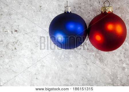 Blue and red Christmas balls on the white snow