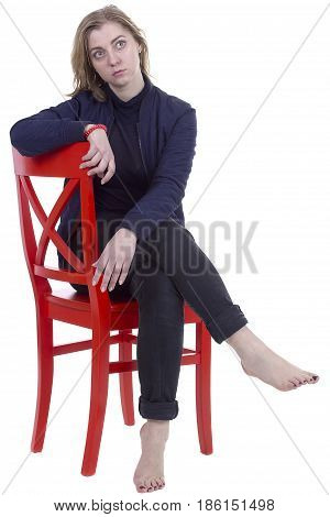 Portrait of a young woman on a red chair