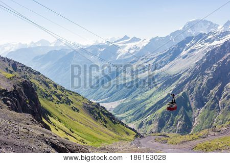The cable car cabin rises up Mount Elbrus on a sunny summer day