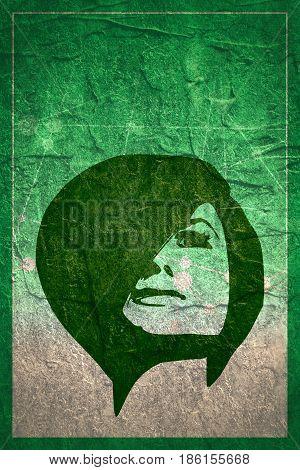 Face front view. Elegant silhouette of a female head. Grunge concrete texture. Short hair. Monochrome gamma.