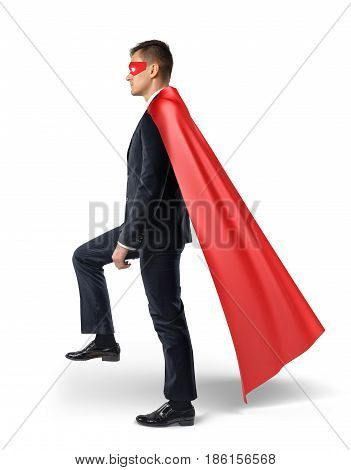 A businessman in a flowing red cape stepping on an invisible ladder. Moving forward. Business and success. Growth and competition.