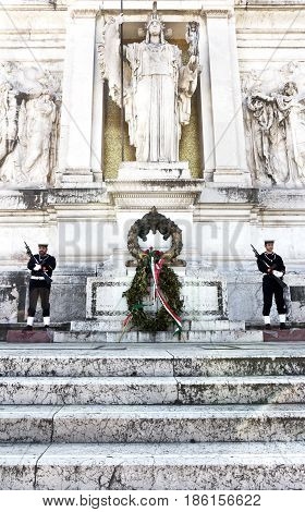 Rome, Italy - March 12, 2017 : Two honor guards guarding the monument to Vittorio Emanuele II or Altar of the Fatherland in Rome, Italy.