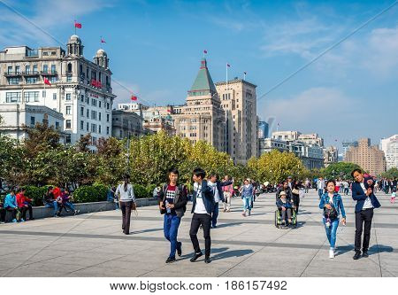Shanghai, China - Nov 4, 2016: Along The Bund Sightseeing Avenue, featuring the unique architecture of the city skyline. Area is very popular with local and foreign visitors.