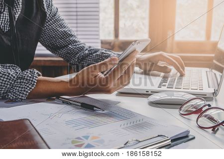 Businesswoman working and using smart phone in hands touching on a screen.Business concept