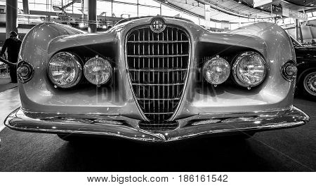 STUTTGART GERMANY - MARCH 02 2017: Sports car Alfa Romeo 1900C Sprint Supergioiello by Ghia 1953. Black and white. Europe's greatest classic car exhibition