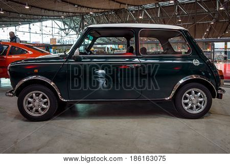 STUTTGART GERMANY - MARCH 02 2017: Small economy car Rover Mini Cooper. Europe's greatest classic car exhibition