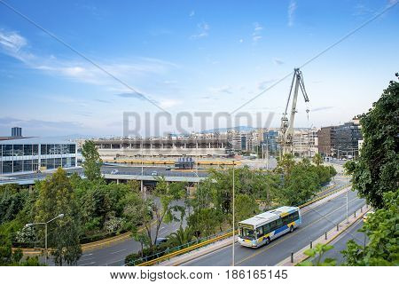 Part view of the port of Piraeus with the cruise terminal and the peripheral road under a blue sky .Greece