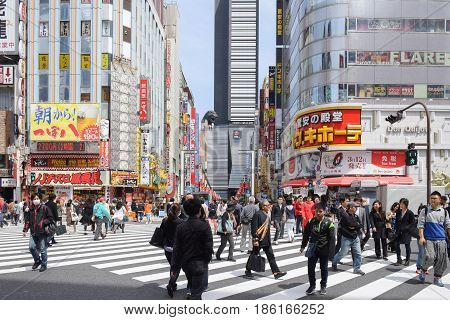Tokyo, Japan - April 18, 2015: Pedestrians Walk At Kabuki-cho District. The Area Is A Entertainment