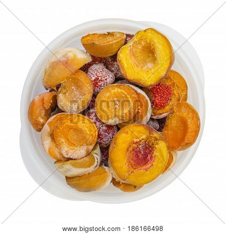 Frozen peaches apricot strawberries in a bowl isolated on white background photo food