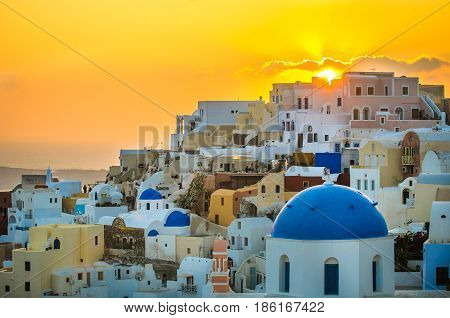 Oia village at sunset Santorini island Greece