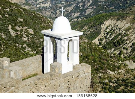 Architectural Christian element at the edge of a Greek Monastery Yard. Surrounded from a mountain breathless view.
