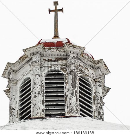 8 sided structure tops church with a cross on top