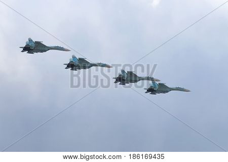 SAINT-PETERSBURG, RUSSIA - MAY 09, 2017: Four multi-purpose SU-27 fighters in the cloudy sky. Fragment of the military parade in honor of the Victory Day