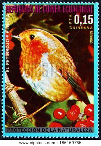 EQUATORIAL GUINEA - CIRCA 1976: a stamp printed in Equatorial Guinea shows European Robin Erithacus Rubecula European Bird circa 1976