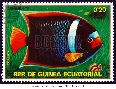 EQUATORIAL GUINEA - CIRCA 1979: a stamp printed in Equatorial Guinea shows King Angelfish Holacanthus Passer Fish circa 1976