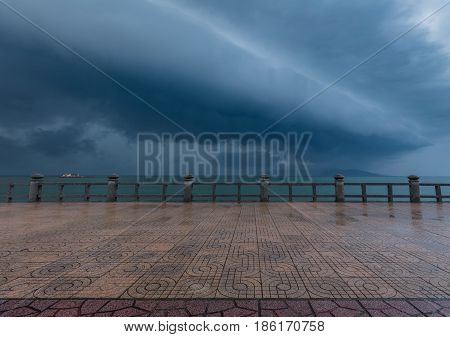 A stormy grey morning sky over the south China sea off the coast of Nha Trang Vietnam.