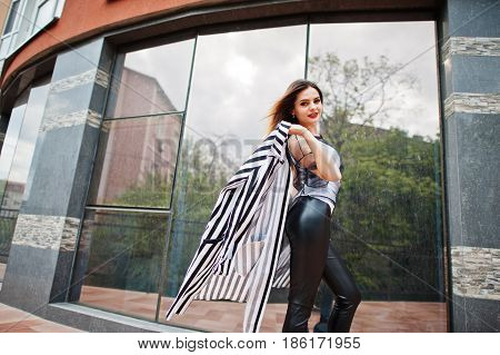 Fashionable Woman Look With Black And White Striped Suit Jacket, Leather Pants, Posing At Street Aga