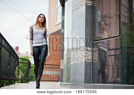 Fashionable Woman Look At White Shirt, Black Transparent Clothes, Leather Pants, Posing At Street Ag