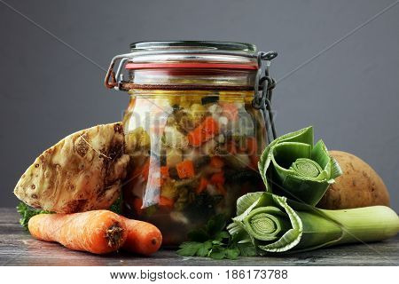 Jar With Variety Of Pickled Vegetables. Carrots, Field Garlic, Parsley In Glas. Preserved Food