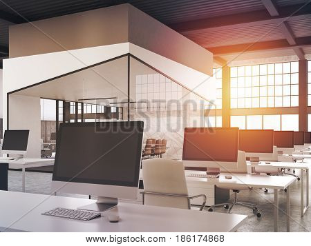 Side view of an open office interior with rows of computer desks and an a aquarium with a conference room in the middle. 3d rendering mock up toned image