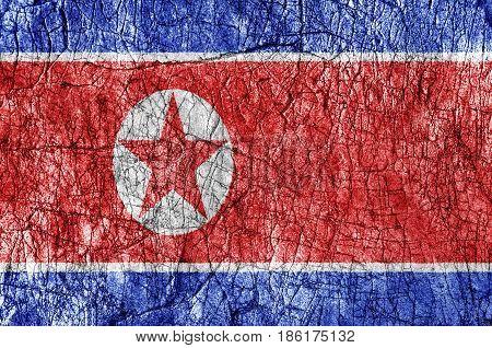 Grudge stone painted North Korea flag close up