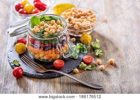 Healthy mason jar salad with chickpea and veggies diet vegetarian vegan food