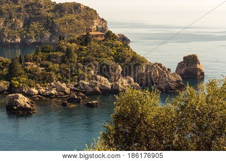 View of island and Isola Bella and blue ocean water in Taormina Sicily Italy