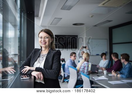 female manager using cell telephone in office interior