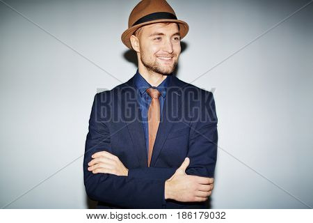 Stylish guy in suit, tie and hat