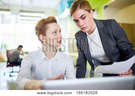 Professional economists or accountants discussing financial project
