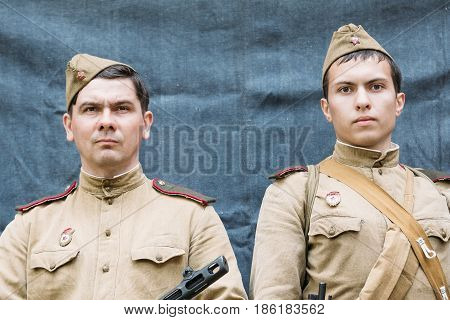 Gomel, Belarus - May 9, 2015: Close up portrait of two unidentified re-enactors dressed as Russian Soviet Infantry Soldiers Of World War II