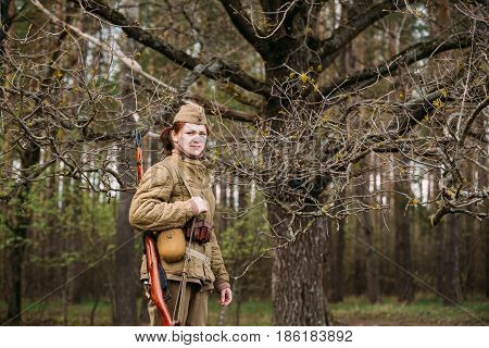 Pribor, Belarus - April 23, 2016: Close Up Portrait Of Young Woman Re-enactor Dressed As Russian Soviet Infantry Soldier Of World War II In Forest