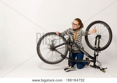 Gomel, Belarus - May 12, 2017: Mountain Bike Trek On A White Background. The Girl Is Fixing.